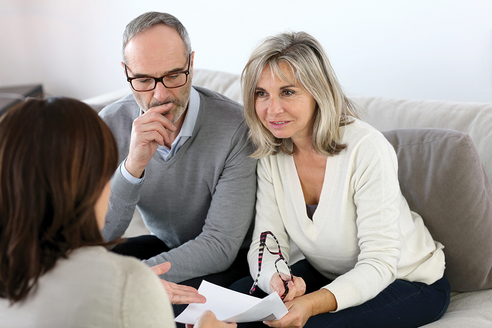 60-year-old couple meeting with financial advisor