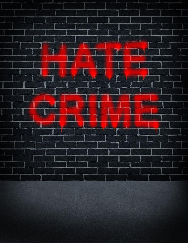 graffiti of hate crime on brick wall